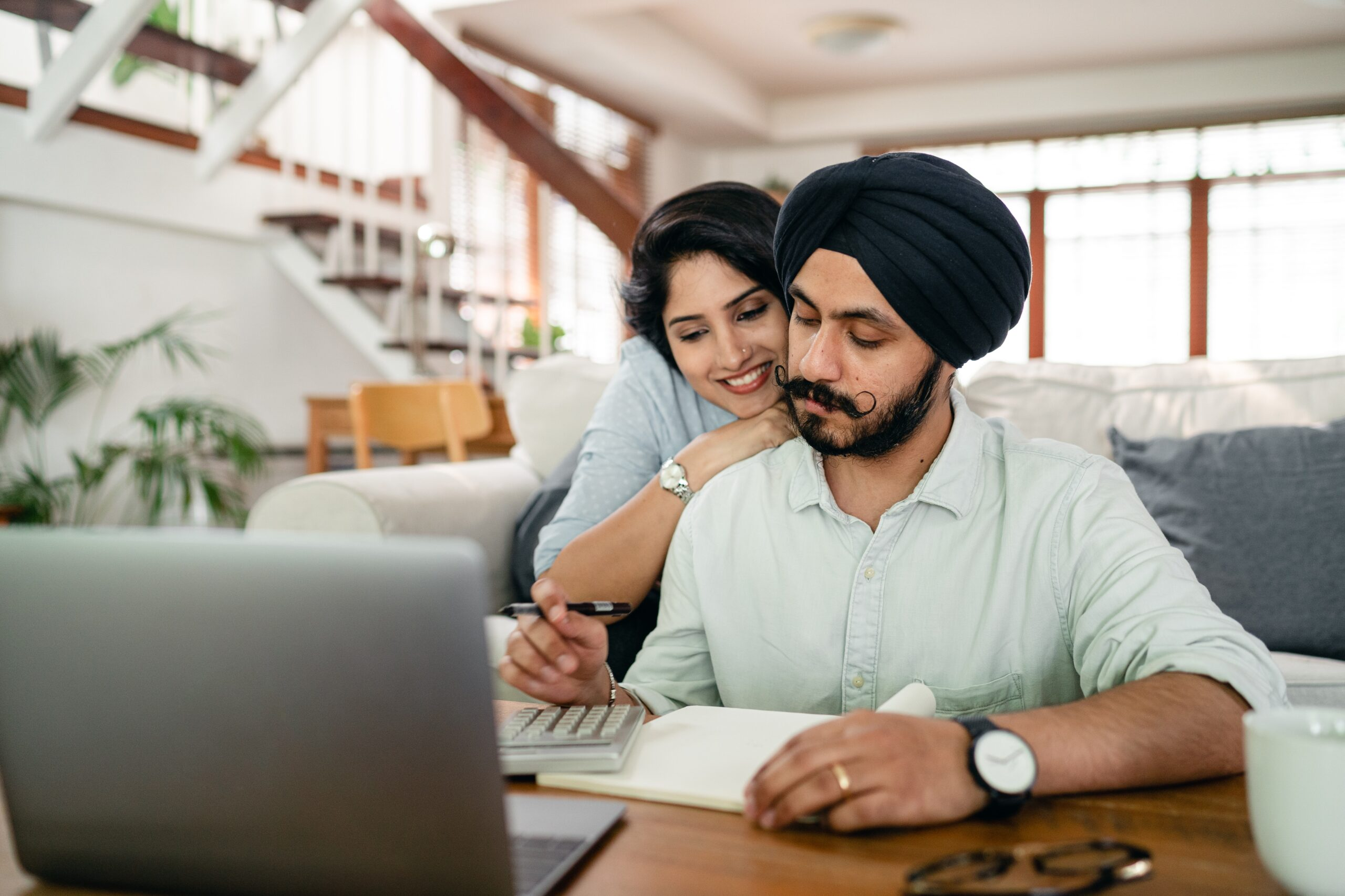 couple looking at laptop monitor